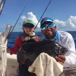 Isiah with his first tripletail off Marathon with Capt. Doug